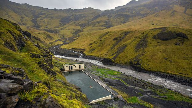 Seljavallalaug thermal pool in southern Iceland is one of the oldest pools in the country (Credit: Credit: Amanda Richter/Getty Images)
