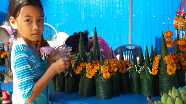 A flower montage made of banana leaves and French marigolds is part of the baci ceremony (Credit: Credit: Anne-Marie Palmer/Alamy)