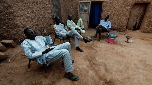 Niger men choose to gather in the streets around a tea kettle rather than indoors (Credit: Credit: Reuters/Alamy)