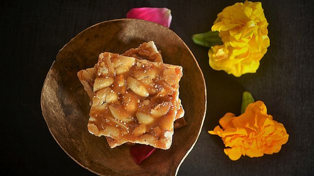 Chikki (peanut or sesame infused jaggery brittle) is a beloved sweet snack for many South Asians (Credit: Credit: Veena Nair/Getty Images)