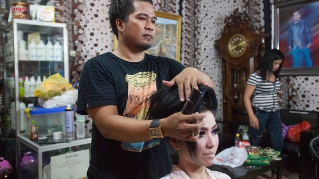 Born into a male body but taking on female gender roles, calabai often work in beauty salons or as wedding planners (Credit: Credit: SOPA Images Limited/Alamy)