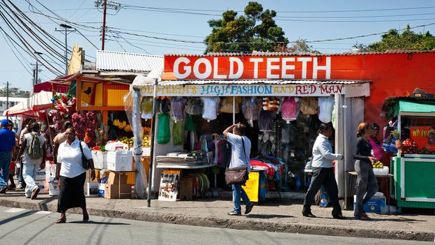 In Trinidad & Tobago, street food vendors hawk different foods and wares (Credit: Credit: Tony Boydon/Alamy)