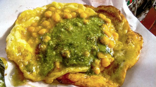 Doubles is a sandwich made from curried chickpeas tucked between two pieces of fried flat bread (Credit: Credit: Barry Ramkissoon/Getty Images)