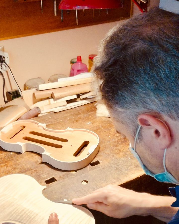 Patrick Orippi working on the back of a violin; he normally makes six or seven instruments a year (Credit: Michela Vado)