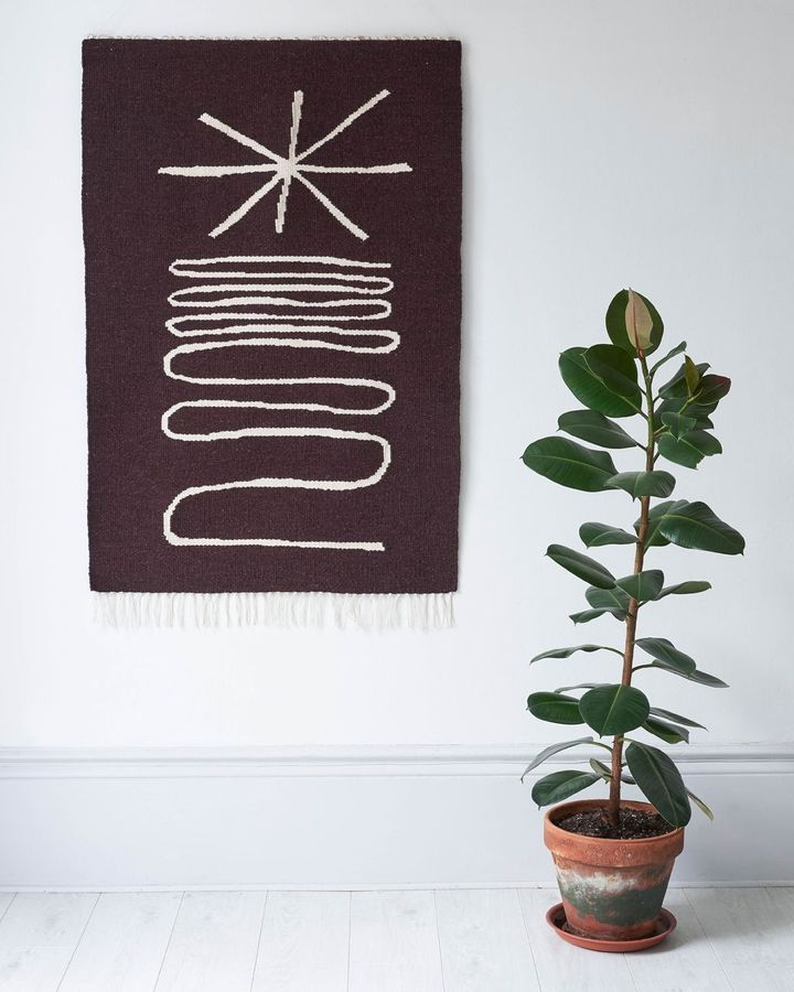 Textiles give interior spaces a warmth and softness, and a cosy, safe ambience – this wall hanging is by Christabel Balfour (Credit: Emma Lewis)
