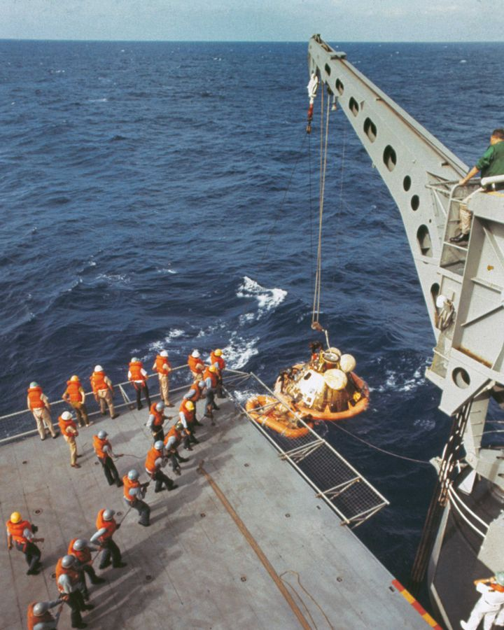 A crane lifts the Apollo 11 capsule onto the ship, but the astronauts were already onboard (Credit: Getty Images)