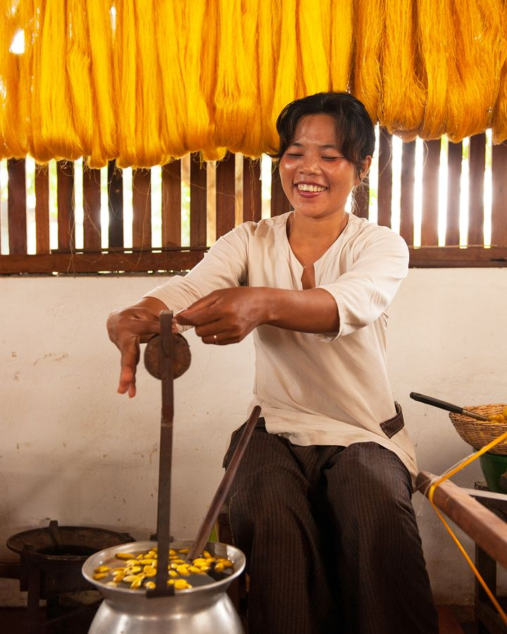 At Golden Silk Pheach, workers unravel silk from the cocoons and later spin it onto bobbins (Credit: Golden Silk Pheach)