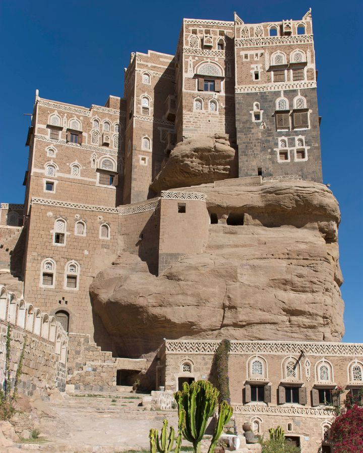 Yemen's monumental Dar al-Hajar palace is built on top of a natural rock spire (Credit: Craig Pershouse/Getty Images)