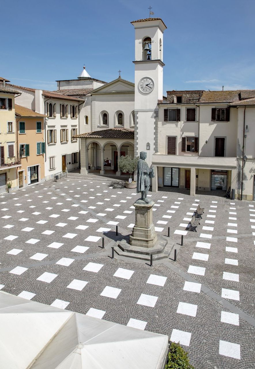 The painted grid pattern blends with the picturesque setting of the square (Credit: Giulio Margheri)