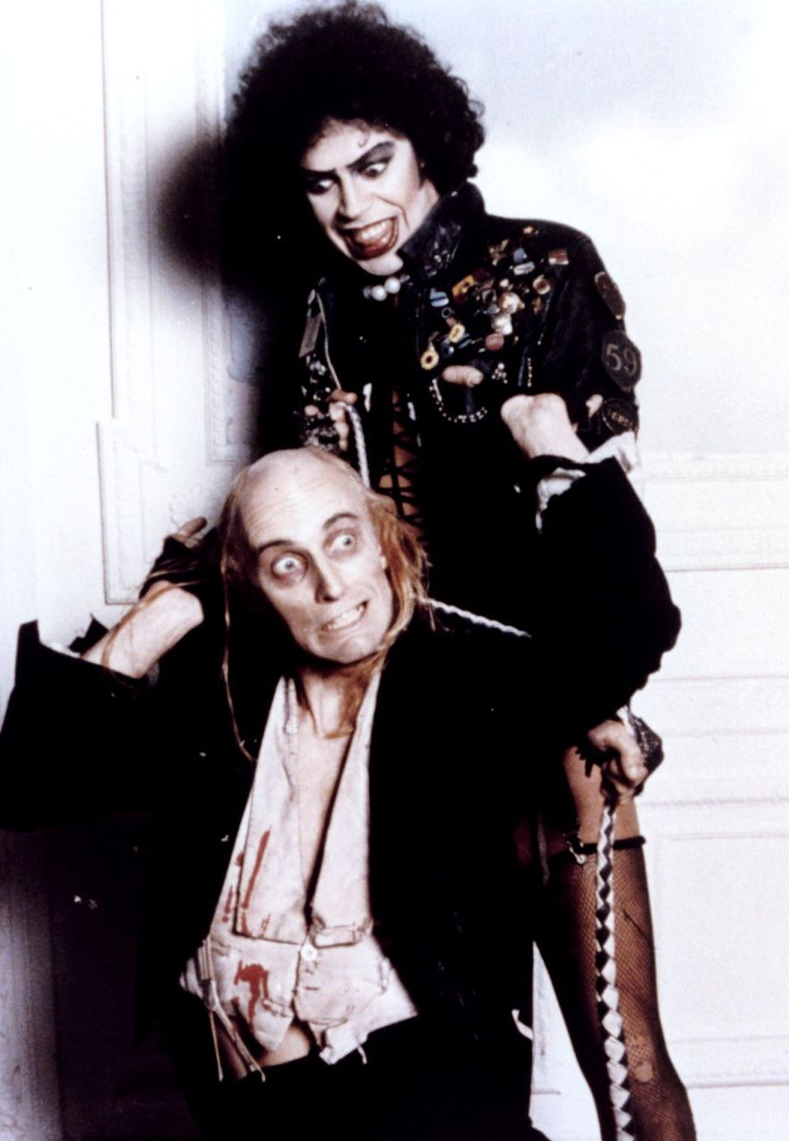 Richard O'Brien (writer of the original stage musical, and co-writer of the film) stars as a servant to Tim Curry's Dr Frank-N-Furter (Credit: Alamy)