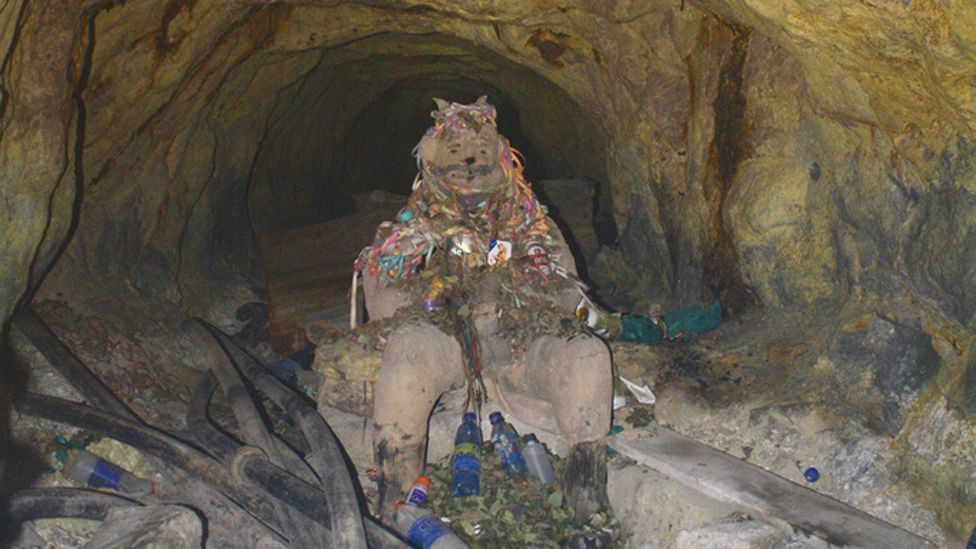 Miners are extremely superstitious – this god of the mines is covered in offerings to appease him and spare the miners lives. (Copyright: Nick Pattinson)
