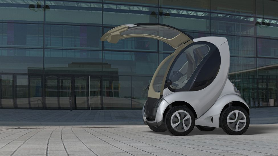The car is driven via an aircraft-style yoke instead of a steering wheel, while its driver and passenger enter and exit via a door in the front of the vehicle. (Courtesy of Hiriko)