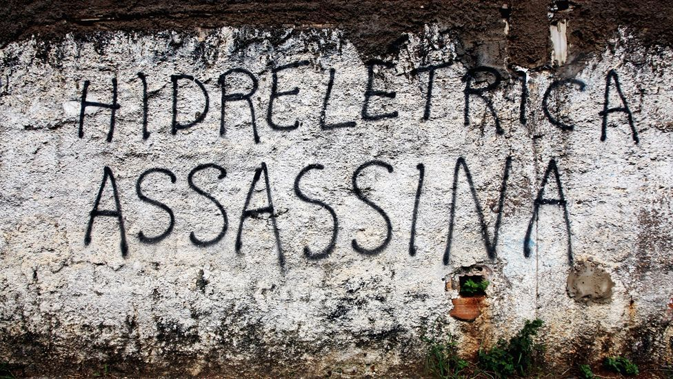 Graffiti denouncing hydroelectric projects near Brazil's Belo Monte dam construction site. Up to 20,000 people will be displaced. (Copyright: Getty Images)