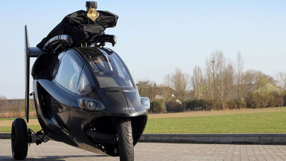 The two-seater, Dutch design, combines an autogyro and three-wheeled scooter. When driving, the rotors fold back. (Copyright: Pal-V)