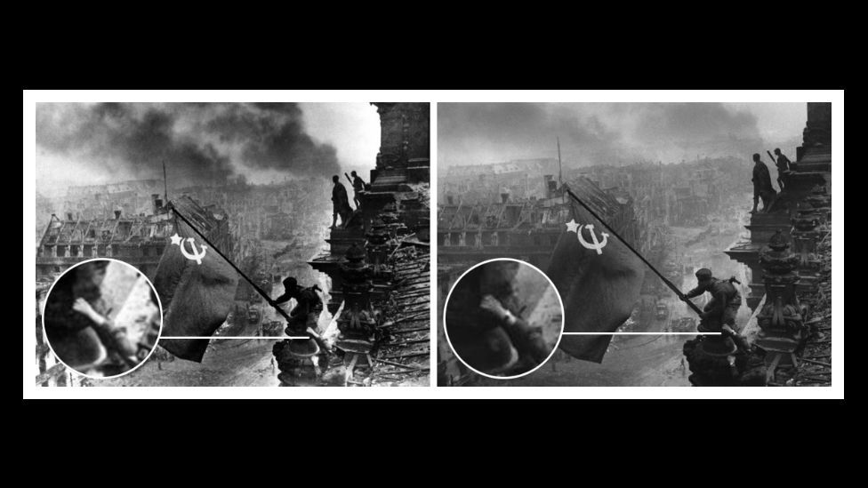 In Yevgeny Khaldei's iconic shot of Soviet soldiers above a ruined Berlin, authorities removed a compass in case anyone thought it was a looted watch. (Courtesy: Fourandsix.com)