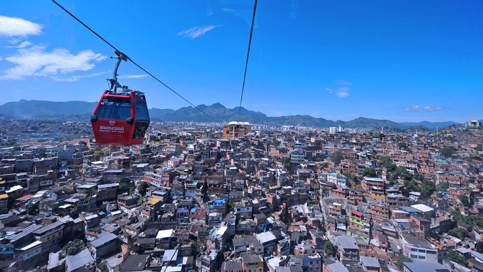 One of Rio's largest slums, the Complexo do Alemao, has a 3.5 km-long cable car system that saves residents hours of journey time to the main city. (Copyright: Getty Images)