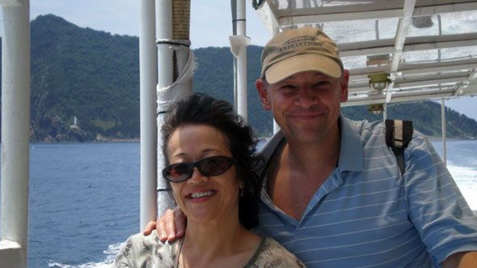 Don George, with his wife, on a ferry off the coast of her home island, Shikoku, Japan.