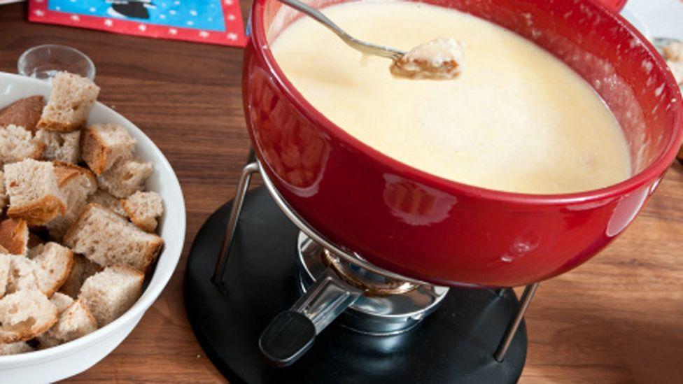Swiss fondue Geneva cheese flame