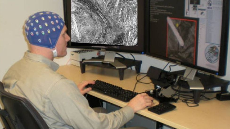 Darpa initiated a progamme to help intelligence analysts identify interesting satellite images. Its filters are trained using brain patterns of skilled personal. (Copyright: Darpa)