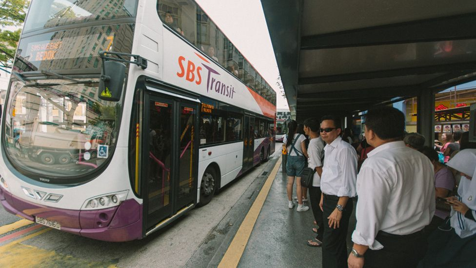 For most city dwellers, catching a bus means going to a designated stop and boarding a service travelling on a set route - a system unchanged for decades. (Copyright: BBC/Marc Tan)
