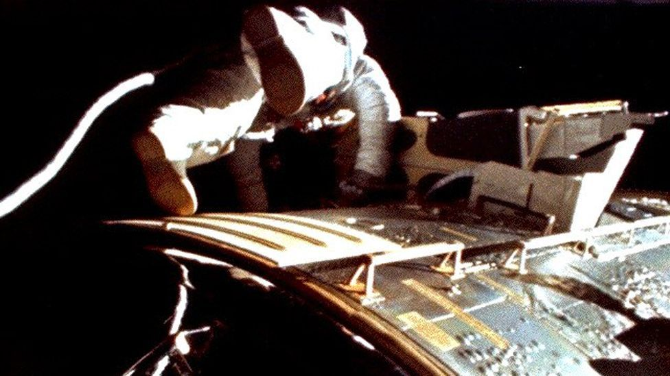 On the way back to Earth, Worden completed a space walk to retrieve film from cameras on the module. This shot was taken by Jim Irwin. (Copyright: Nasa)