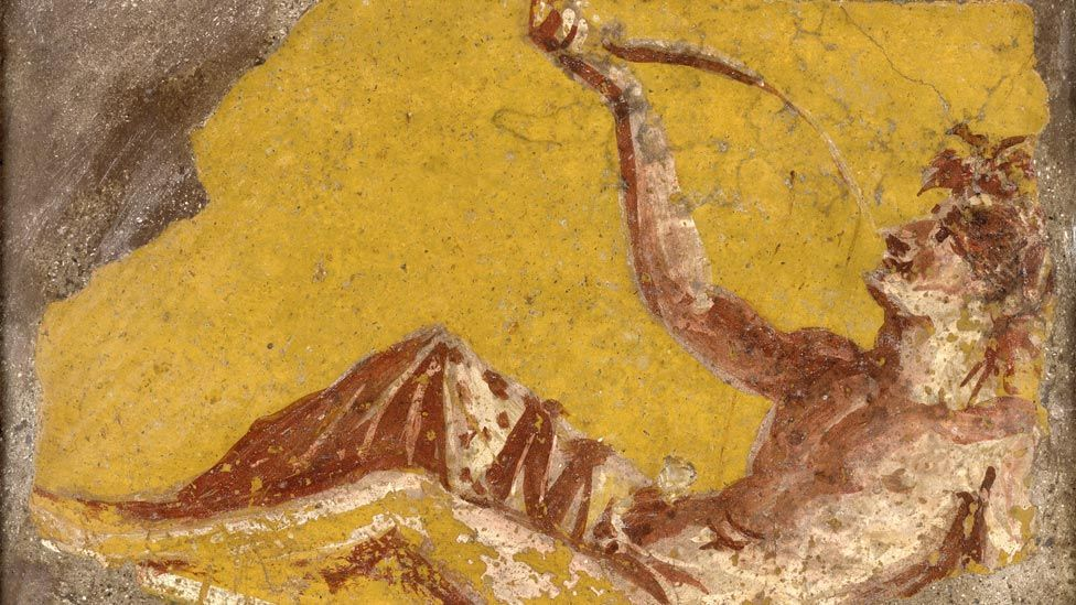 This fragment of a wall painting from Pompeii shows a man reclining to drink. Violence, sex and indulgence pervaded Roman culture.  (British Museum)