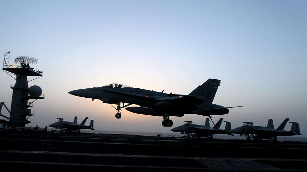 The military has been at the vanguard of automation, using systems that can automatically land a plane on the deck of an aircraft carrier for many years. (Copyright: Getty Images)