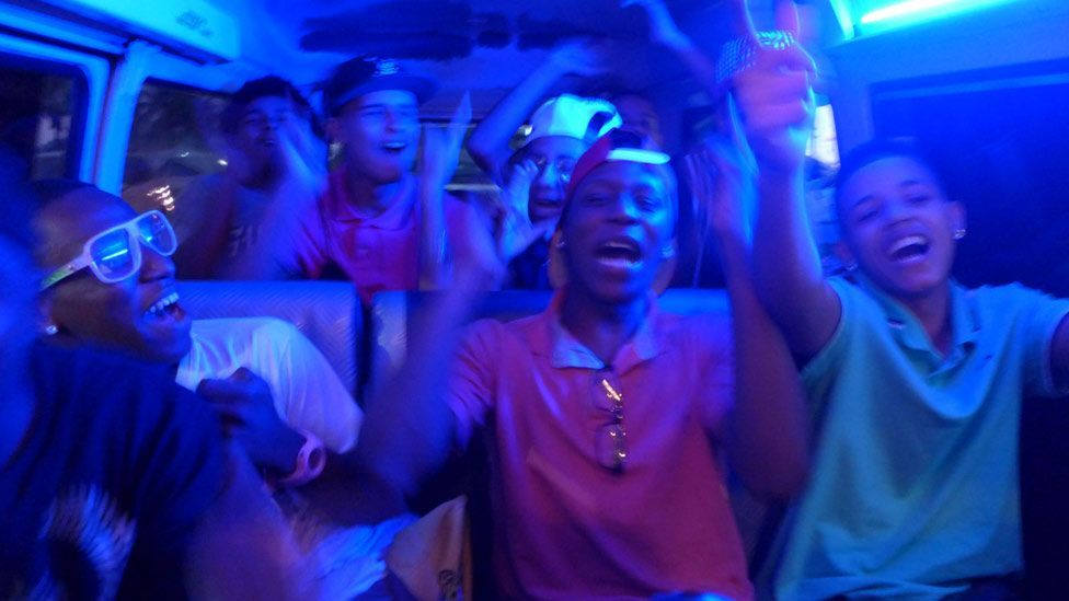 Dancers in a van on the way to a passinho battle – they form strong friendships and the competition is also about having fun. (Julia Carneiro)