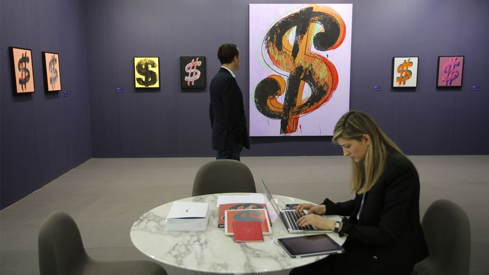 Andy Warhol's silk-screened dollar signs on offer at Art Basel Hong Kong were a reminder that the fair – and art in China – mean business. (AP/Vincent Yu)