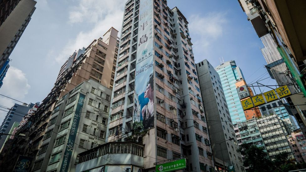 Hong Kong recently raised its tax for property purchases, deterring some foreign buyers. Experts predict a 10% to 15% decline in prices in the city. (Philippe Lopez/Getty Images)