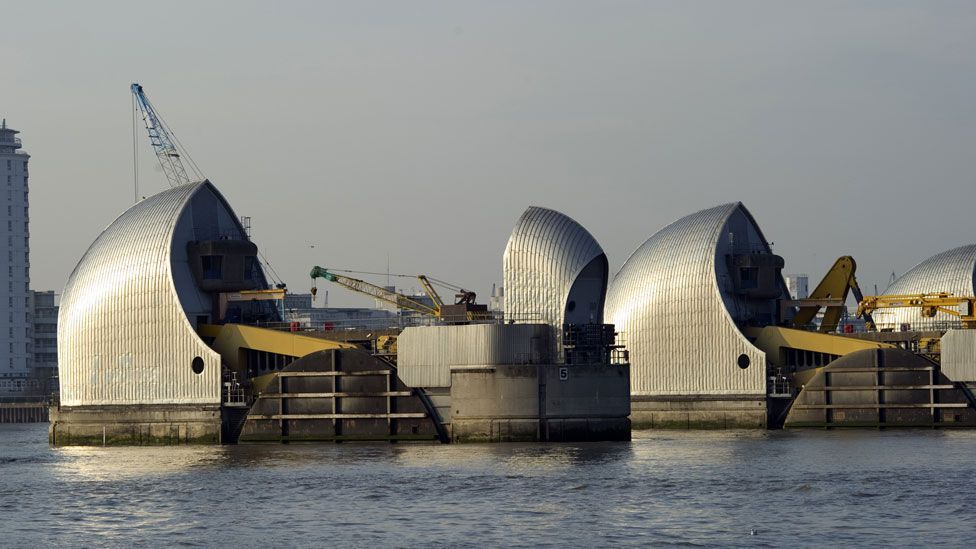 Cities are investing in new sea walls or high-tide gates to stem the threat, like the Thames Barrier in London. (Copyright: Getty Images)