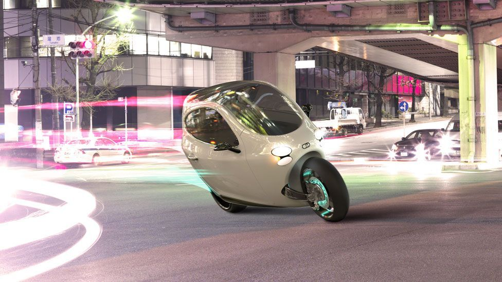 Jon Stewart takes a closer look at Lit Motors prototype electric vehicle that the firm hopes will change the way we travel in cities. (Copyright: Lit Motors)