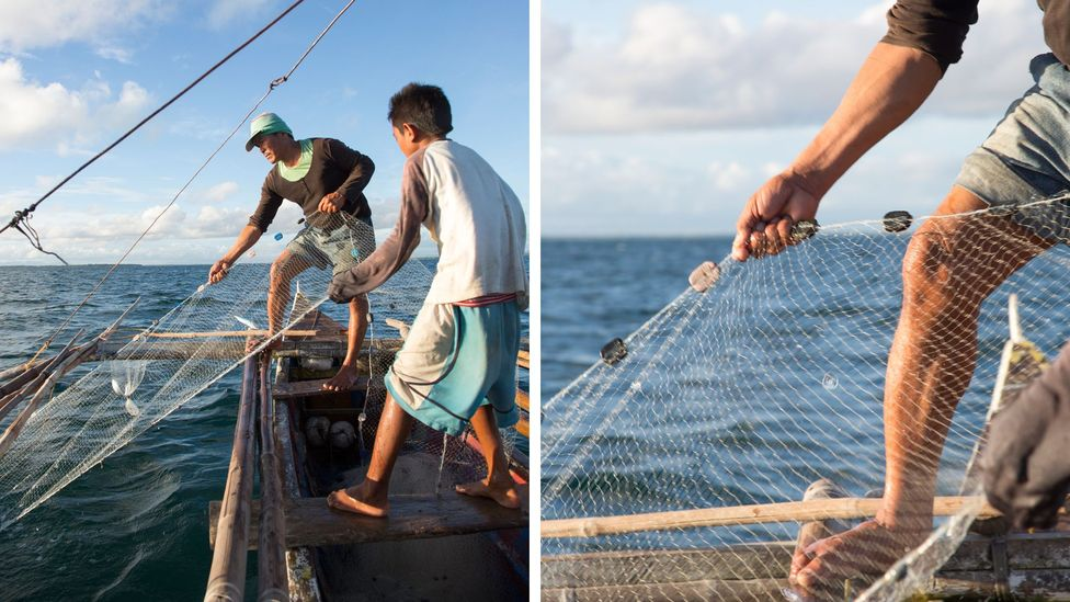 Fishermen in the Philippines gather nets on the water. (Interface, Inc.)