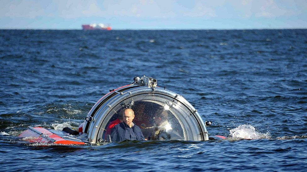In one of his action stunts, Vladimir Putin boarded the Sea Explorer 5 to travel to the bottom of the Gulf of Finland. (Rex Features)