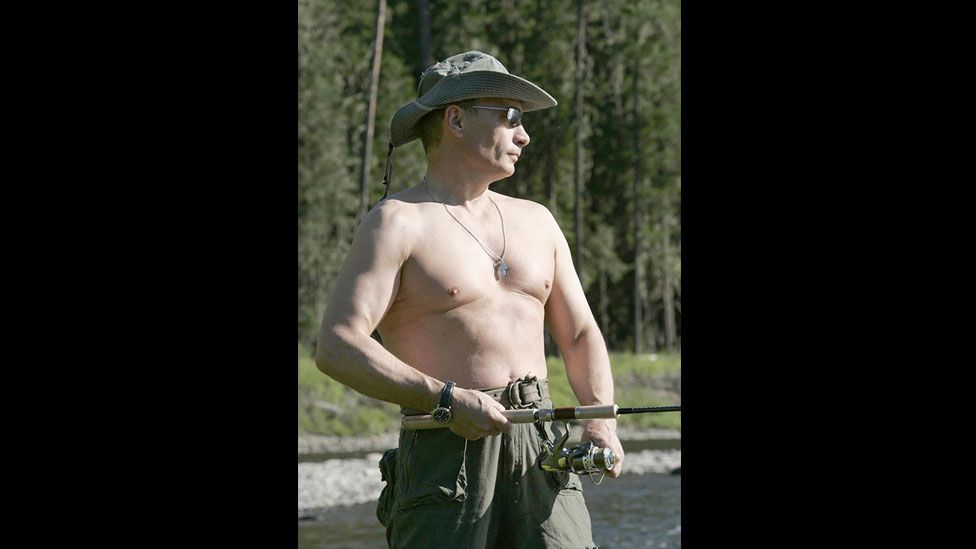 Numerous shots picture Putin bare-chested, including this 2007 image of him fishing in the Yenisei River near Mongolia. (Getty Images)