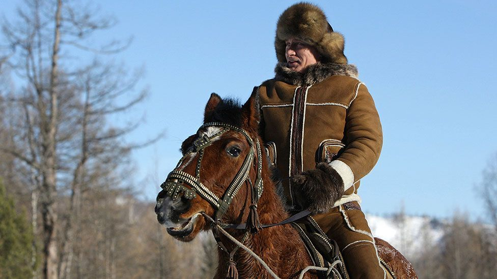 Often pictured engaged in action sports, Putin takes a horseback ride in the Karatash area, during his working trip to Khakassia in 2010. (Getty Images)