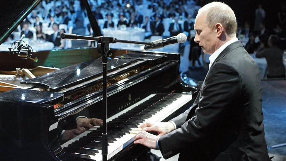 Immaculately turned out in white tie and tails, Putin made his ivory-tickling and singing debut during a charity concert in Saint Petersburg in 2010. (Getty Images)