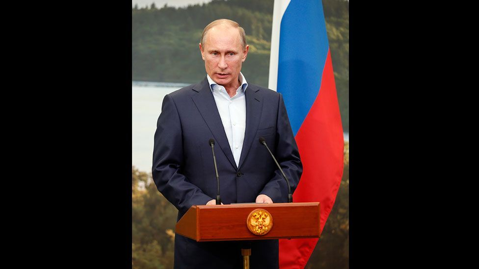 While giving a speech at the G8 summit in Northern Ireland, Putin presented a stiffly-starched and crisp-shirted image of authority and control. (Getty Images)