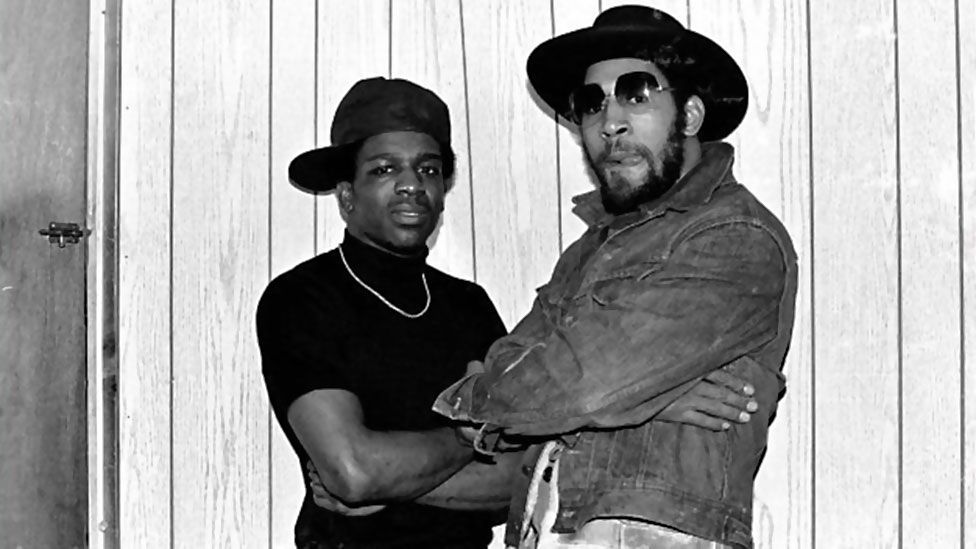 DJ Kool Herc (pictured right, with DJ TonyTone) is credited with introducing hip hop's signature 'breaks' and bringing the MC 'toasting' style from Jamaica.