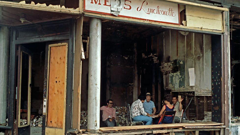 Card players in a fire-bombed shop. The Bronx experienced a sustained period of urban decay and an epidemic of arson in the 1970s. (Photo: Corbis)