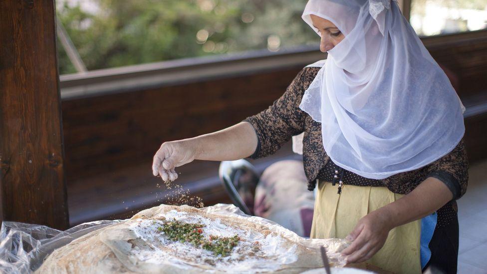 A Druze woman cooking (Credit: Itamar Grinberg/GoIsrael.com)