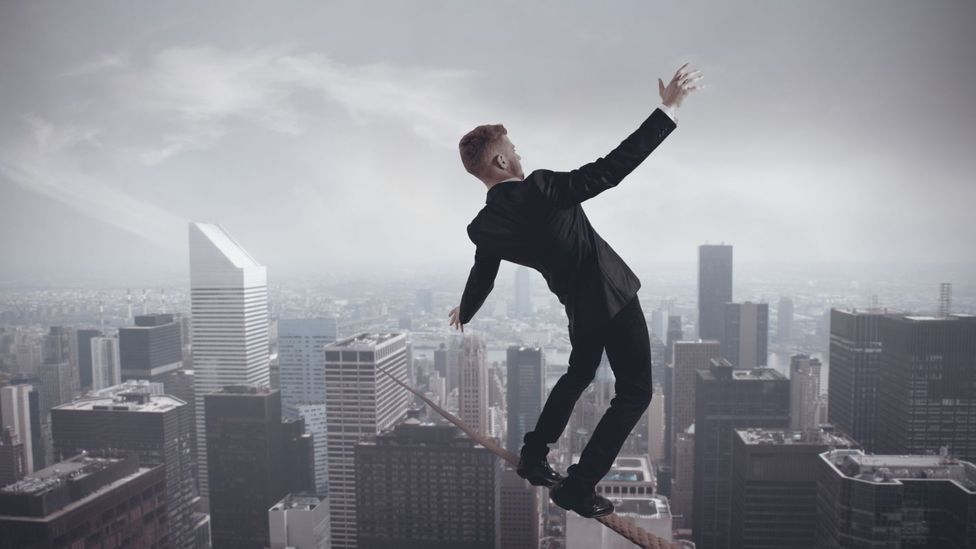 Walking the tightrope at work (iStockphoto)