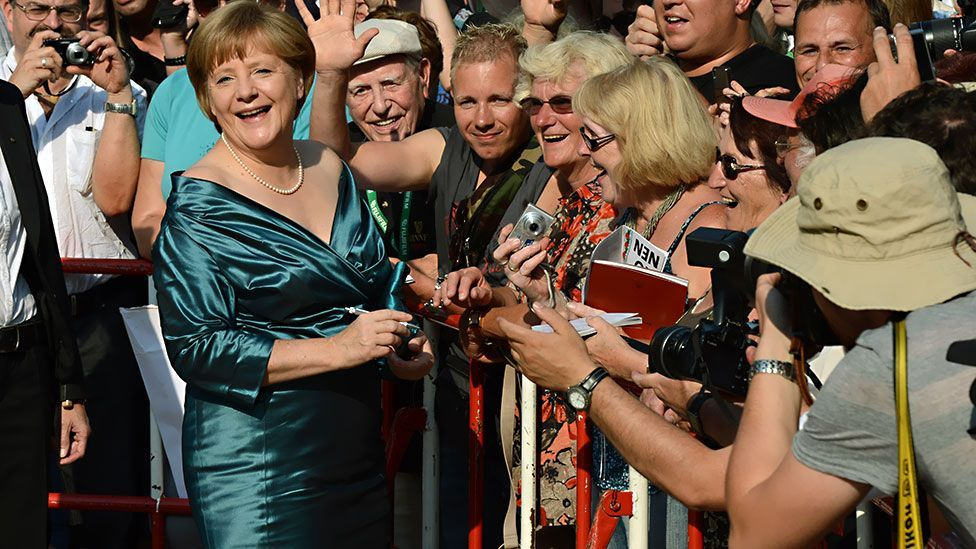 Critics have lined up to comment on Merkel's style and looks – including former Italian prime minister, Silvio Berlusconi. (Getty Images)