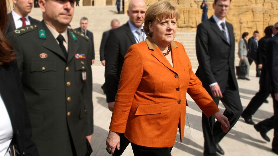The chancellor has taken some criticism on board – recent years have seen her incorporate more brightly jewelled colours into her wardrobe. (Getty Images)
