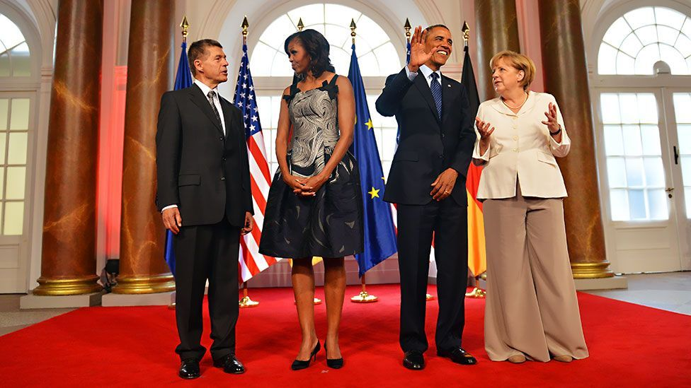 German-born fashion designer Karl Lagerfeld spoke critically about Merkel's too-long trousers on an engagement with the Obamas this year. (Getty Images)