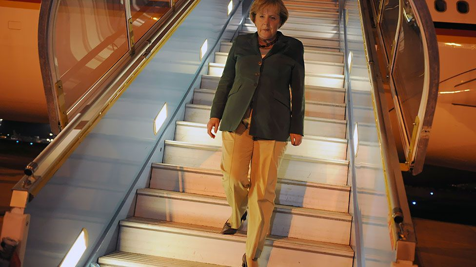 Merkel's fondness for simple trouser suits has led to sartorial comparisons with Hilary Clinton. (Getty Images)