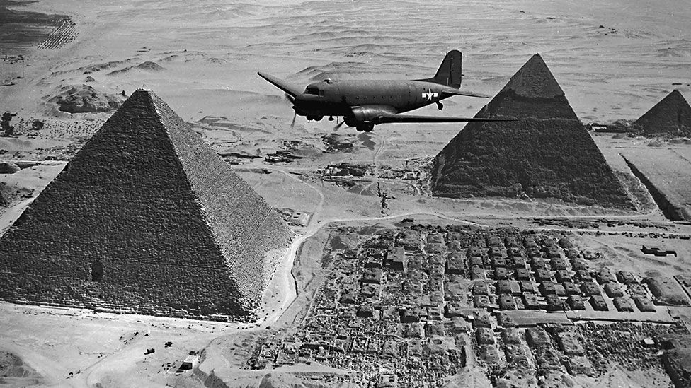 The US Army Air Force used DC-3s extensively in World War II, like this Dakota transport variant flying urgent war supplies over Egypt in 1943. (Keystone/Getty)