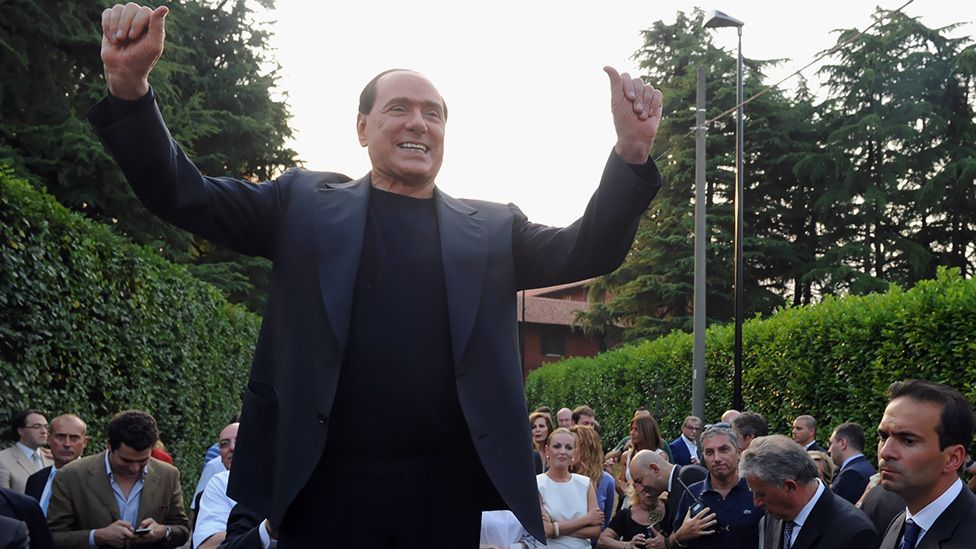 Berlusconi hails his supporters in front of his house, the Villa San Martino in Milan, Italy after his guilty verdict this year. (Getty Images)