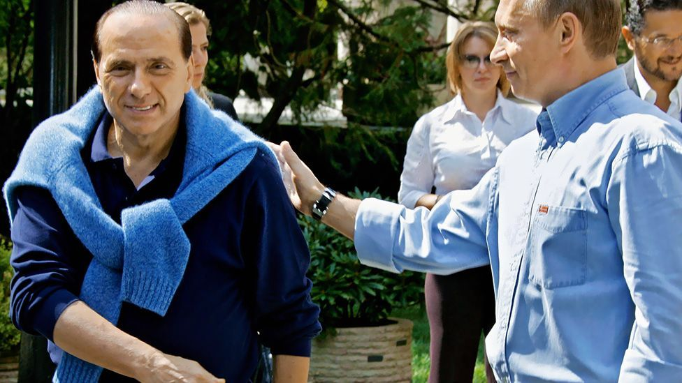 With Russian President Vladimir Putin in the Black Sea resort of Sochi in 2005, Berlusconi created a more smart-casual presence in a sweatshirt. (AFP/Getty Images)