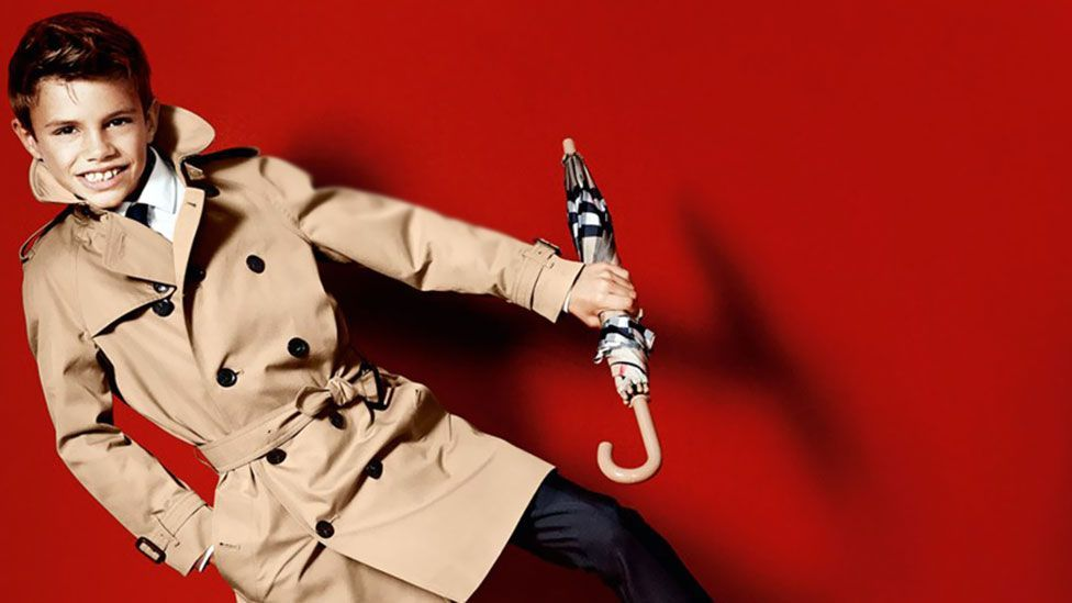 Romeo Beckham, the 10-year-old son of David and Victoria, was in Burberry's spring/summer 2013 adverts, sporting a child-sized version of the famous coat. (Burberry)